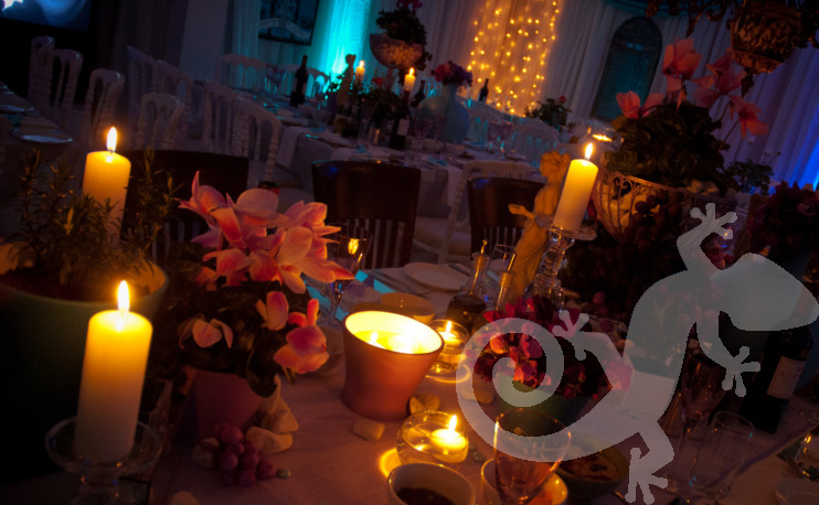 candle-lit island table setting, lighting, Greek theme