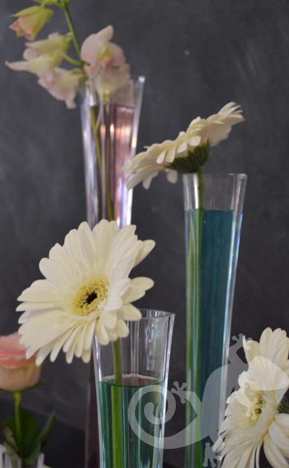 Modern designer wedding flowers, coloured water