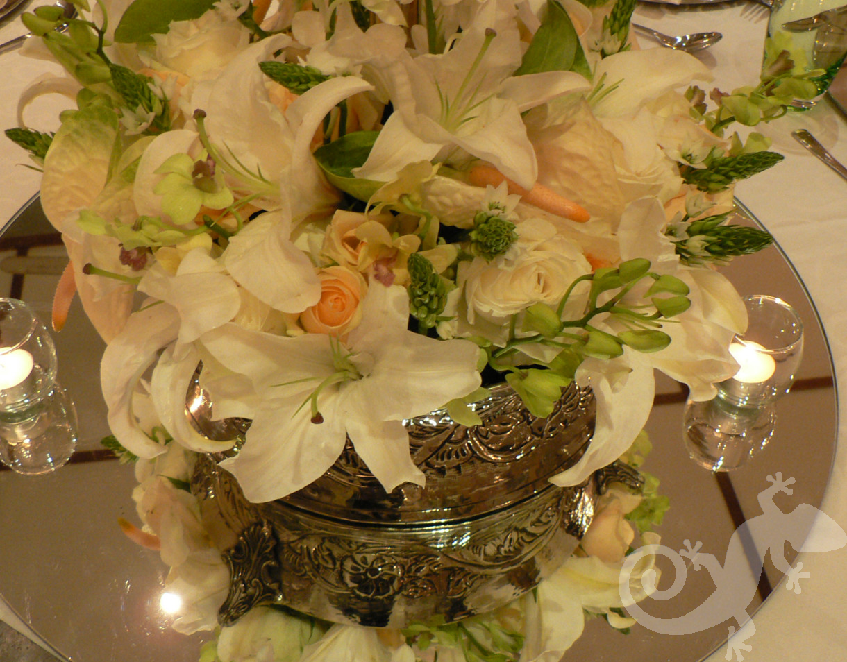 Exquisite arrangements, silverware, mirrored base